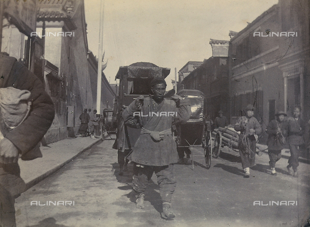 Men working on a street in a Japanese town