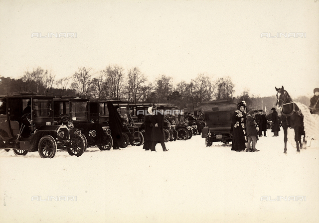 Stockhom Winter Games. Automobiles parked in the snow.