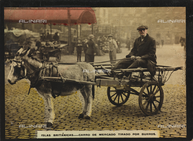 A man on a market cart pulled by a donkey
