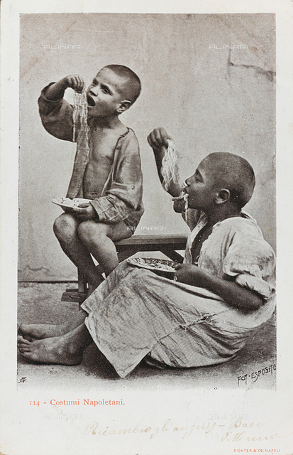 Costumes of Naples. Portrait of two children eating a plate of spaghetti with their hands, postcard