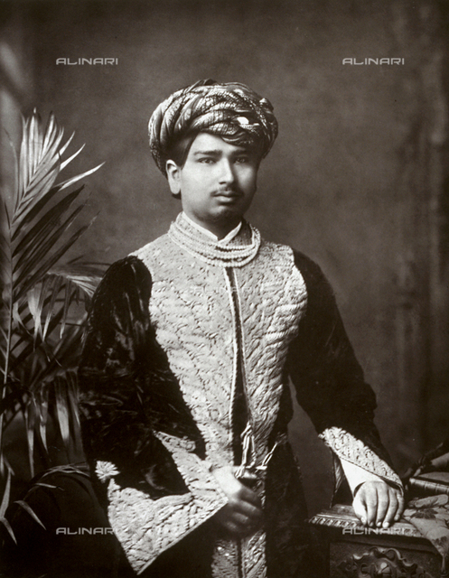 Three-quarter-length portrait of His Highness Balsingji Chandrasingji, Thakore of Wadhwan, in sumptuous traditional clothes
