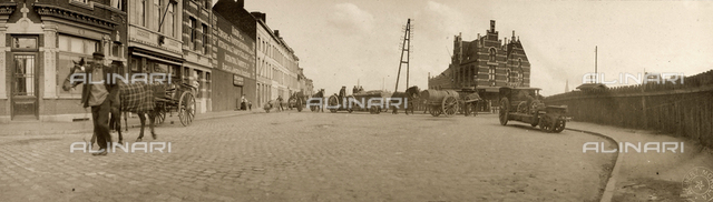View of a street of Antwerp, Belgium. In the background, the Dam railway station.
