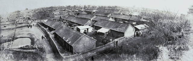 Panorama of a city in upper China or Korea. In the foreground, numerous houses