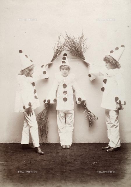 Children in Pierrot costumes
