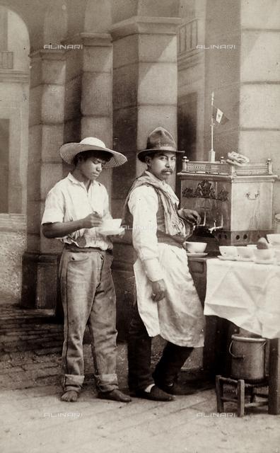 Portrait of a Mexican beverages vendor with a client.