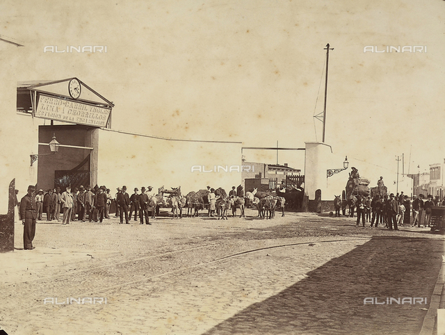 People with horses and livestock in front of the train station of the Chorrillos neighborhood in Lima