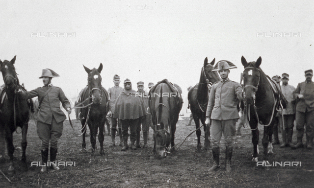 Portrait of a group of carabinieri with their horses