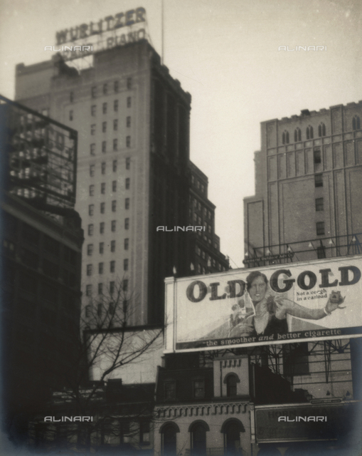 View of skyscrapers in New York City. In the foreground, a billboard advertising a brand of cigarettes.