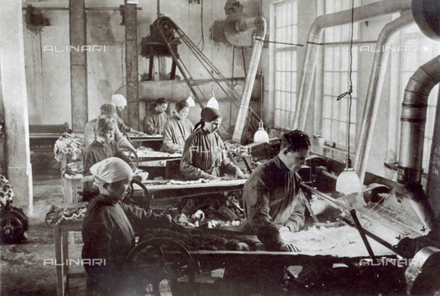 Groups of engaged workers in a Russian tannery.