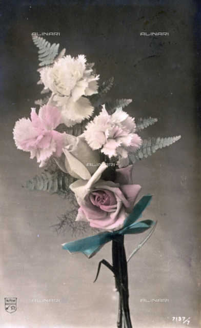 Small bouquet of flowers composed of carnations and roses