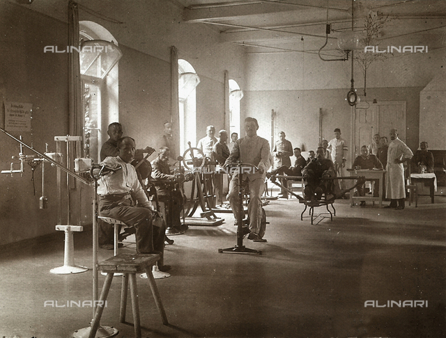 Patients in a gymnasium inside a military hospital