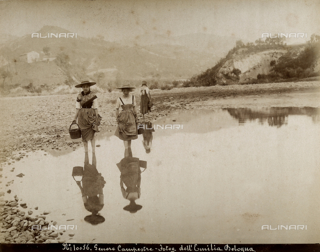 Girls fording a river