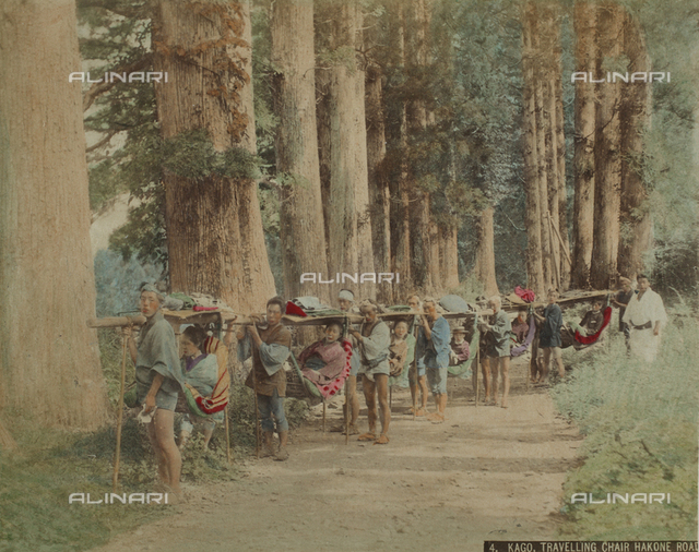 A group of geishas transported with the typical Japanese sedan Kago