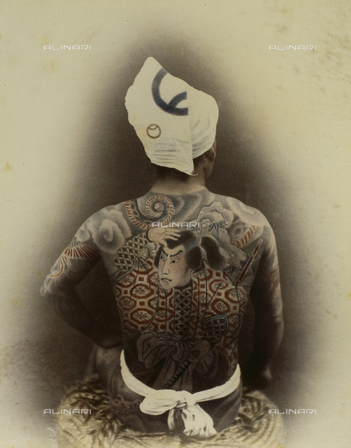 The body of a young Japanese completely covered in tattoos