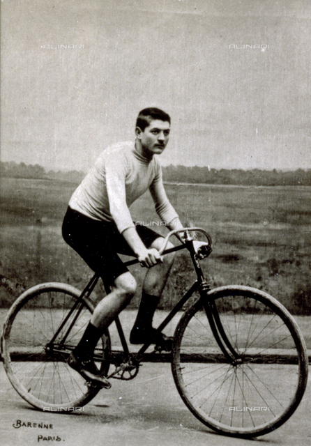 Portrait of the French racing cyclist Constant Huret on his bicycle