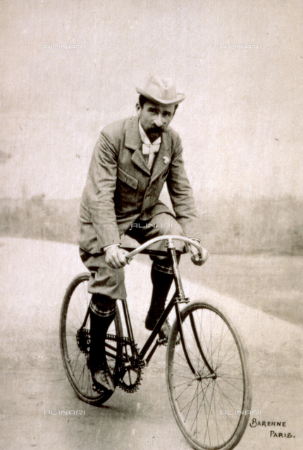 Portrait of the French racing cyclist Gaston Rivièrein riding a bicycle