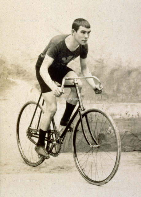 Portrait of the famous Welsh racing cyclist Tom Linton riding a bicycle