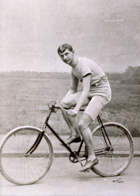 Portrait of the United States racing cyclist Arthur Augustin Zimmermann riding a bicycle