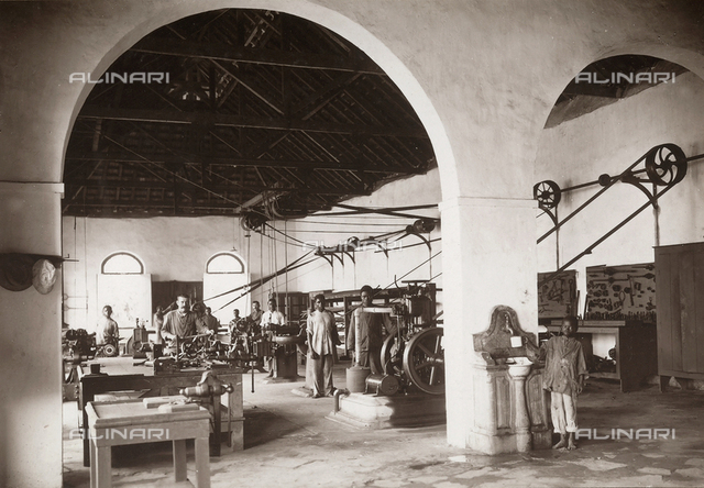 Workers operating ice-making machinery, in the Agua-izé factory, locality of the island of Sao Tomé, west side of Africa