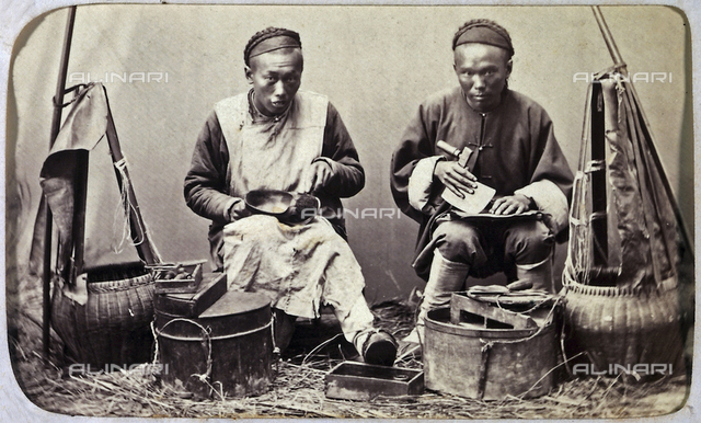 Two Chinese artisans working