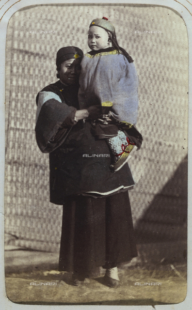 Portrait of a Chinese woman holding her daughter