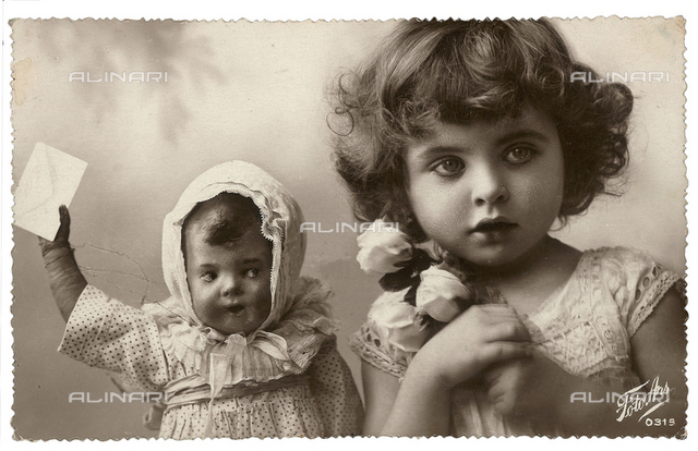 Portrait of a young little girl with a doll, post-card with a postage stamp indicating as date of dispatch the 5th of November 1931 and the town of Poffabro, Udine, Italy