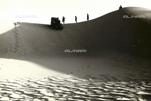 A car on a large dune in Nigeria