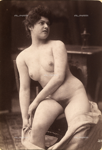 Portrait of a nude woman sitting