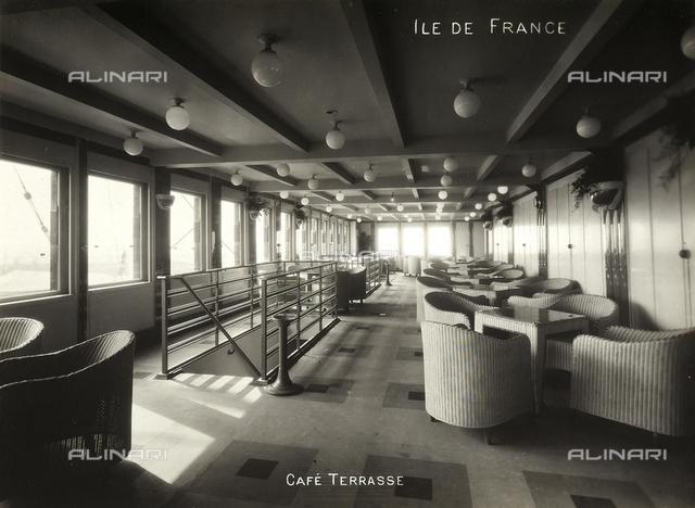 The terrace of the Café onboard the Ile de France passenger liner