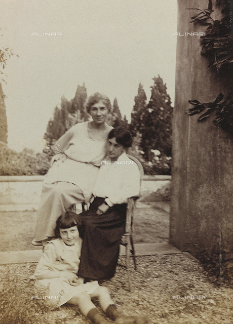 Two women and a child in the garden of Villa Le Balze, formerly Villa Strong, Fiesole