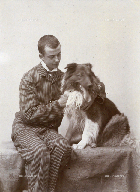 Portrait of a young man with his dog