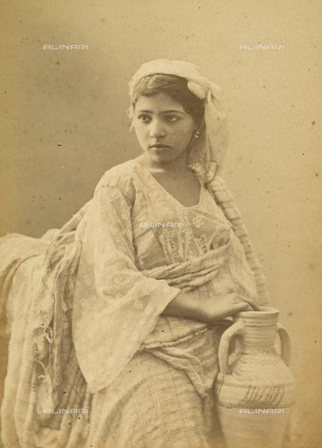 """""""Souvenir de l'Algerie"""": young Algerian woman photographed in her home"""