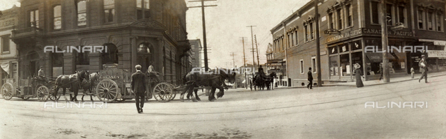 Carriages and passersby on the streets of a city in Canada
