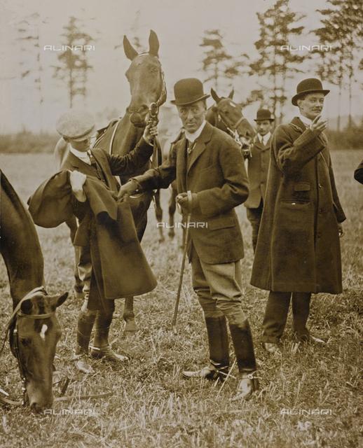 Group of gentlemen with horses
