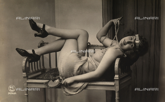 A young woman posing on an arm chair