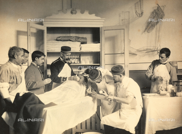 Military hospital in Africa: medical staff photographed during a surgery on a young patient