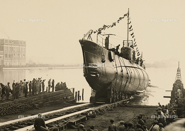 "Workers from the naval shipyard of Monfalcone salute the submarine ""Velella"" upon its launching"