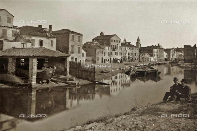 Two men photographed at the squero of Santa Maria in Venice