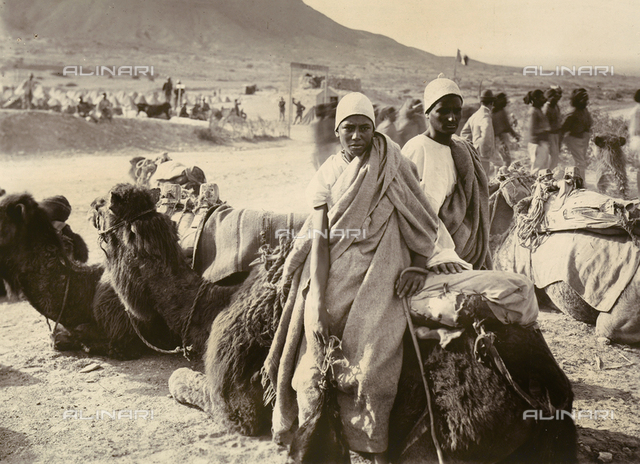 Scenes of Tripolitania during the Italian occupation, April 29-May 11, 1914: two young Arab men with their camels