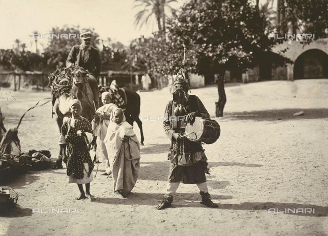 Scenes of Tripolitania during the Italian occupation, April 29-May 11, 1914: a native wearing a traditional Arab mask