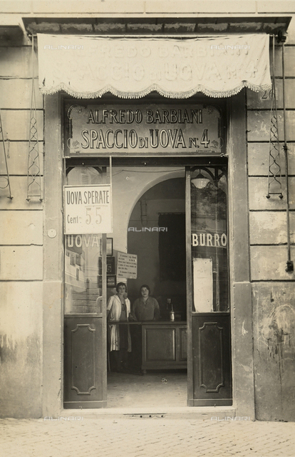 Alfredo Barbiani Firm: shop for the sale of eggs on Via Emanuele Filiberto in Rome; clerks are behind the counter