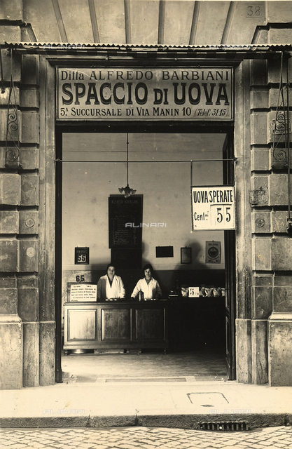Alfredo Barbiani Firm: shop for the sale of eggs on Via dei Serpenti in Rome; clerks stand behind the counter