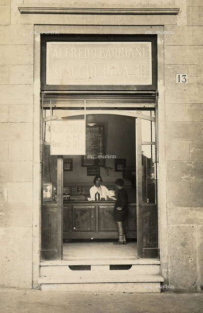 Alfredo Barbiani Firm: shop for the sale of eggs on Via Majella in Rome, with a clerk and young boy at the counter