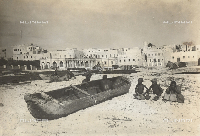 Repair of a pirogue on the beach, Mogadishu, Somalia