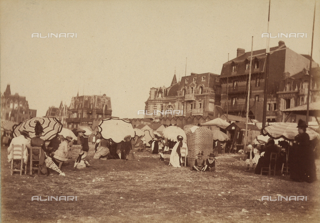 Beach at Villers-sur-Mer, near Deauville, France. Several people relaxing on the beach