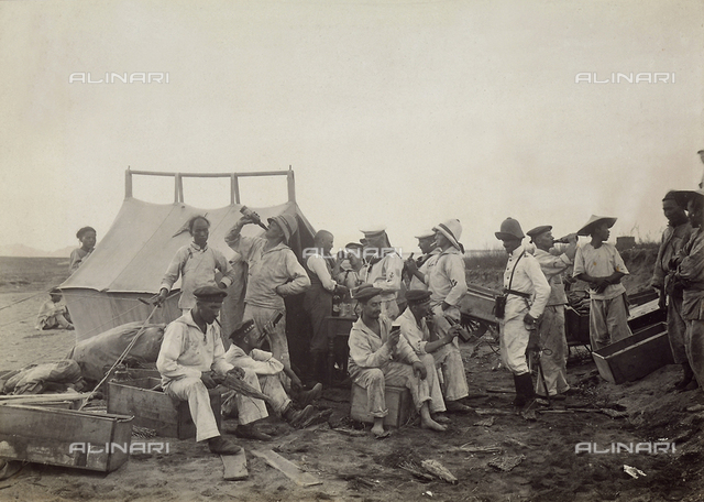 A group of Western soldiers eating at a small Chinese kiosk