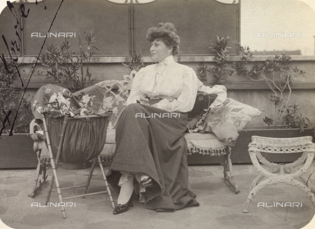 Woman on a sofa on the terrace