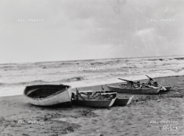 A boat and two patines on the beach of Viareggio
