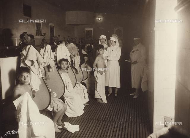 """Album """"School Giacinto Pacchiotti, photographs taken during the visit of HRH Princess Lydia Duchess of Pistoia"""": group photo with the princess during the visit to children"""