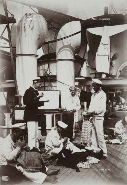 "Crew of the ship ""Donau"" (Danube) while sewing their clothes"